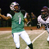 Tatum's Dariam Brooks throws a pass as Arp's Jeremy Shelton closes in Friday, August 31, 2012 at Eagle Stadium in Tatum. (Justin Baker/News-Journal Photo)