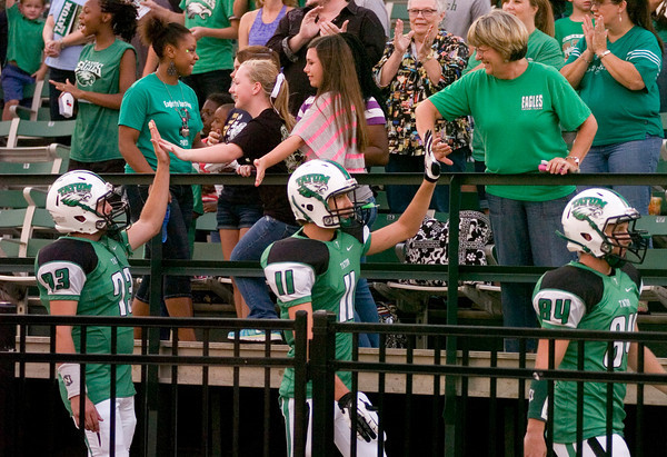 Spectators line the rail to high-five Tatum players as they enter the stadium for their season opener against Arp Friday, August 31, 2012 at Eagle Stadium in Tatum. (Justin Baker/News-Journal Photo)