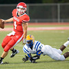 Carthage quarterback #4 slips a tackle during Friday's August 31, 2012, game against Jacksonville. (Les Hassell/News-Journal Photo)
