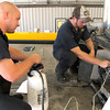 Truck Mechanic Blaize Parvin, left, and mechanic Cory Maxwell, right, bleeds a clutch on a crane Wednesday, August 29, 2012, at Joyce Crane in Longview.  (Kevin Green/News-Journal Photo)