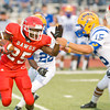 Carthage's #25 fights for yardage during Friday's August 31, 2012, game against Jacksonville. (Les Hassell/News-Journal Photo)