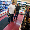 Keith Burks, left, and Courtney Burks, right, shop for beer and wine Monday, Dec. 31, 2012, at Skinner's Corner Store in Lakeport.  (Kevin Green/News-Journal Photo)