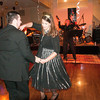 Josh and Ashley McClanahan, of White Oak dance during the Ambucs New Year's Eve Bash Monday, Dec. 31, 2012, at the Arbella Manor in East Mountain.  (Kevin Green/News-Journal Photo)