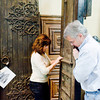 Sharon and David Cox of Eclectic Architecturals move a door for display on Wednesday February 29, 2012. (Michael Cavazos/News-Journal Photo)