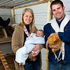 Aaron Perkins with his wife, son and chickens Tuesday, Jan. 3, 2012. (Les Hassell/News-Journal Photo)