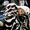 Nancy Arenas, 7, tries to stay warm while watching a soccer game Tuesday, Jan. 3, 2012 at Longview High School. (Les Hassell/News-Journal Photo)