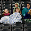 Soccer fans bundle up to stay warm while watching a soccer game Tuesday, Jan. 3, 2012 at Longview High School. (Les Hassell/News-Journal Photo)