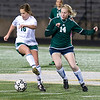 Longview High School's Molly Grisham, left, and 2009 graduate Sarah Bradley battle for control of the ball during the Longview High School girls soccer team annual alumni soccer game Tuesday, Jan. 3, 2012 at Longview High School. (Les Hassell/News-Journal Photo)