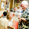 Gary Boyd visits with his granddaughter Hannah Davison at The Back Porch in Kilgore while awaiting the results for the Gregg county runoff elections, on Tuesday, July 31, 2012. (Michael Cavazos/News-Journal Photo)