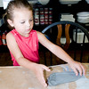 Leslie Farrant,5, of Houston lays her footprint on the table during the flip flop project at Create Art! Wednesday, June 20, 2012, in Longview.  (Kevin Green/News-Journal Photo)
