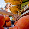 DeAnn Thacker keeps her shelves stocked with peaches and various other items while running Gilmer Produce out of a road side stand at the intersection of Titus Street and U.S. 271 on Wednesday, June 20, 2012. (Michael Cavazos/News-Journal Photo)