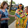 Louriee Palmer, right, and Danny Galvez hand out leis at the Denim and Diamonds fundraiser Saturday, March 31, 2012. (Les Hassell/News-Journal Photo)