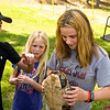 Nikki Young plays with a turtle at the Fete for Pets fundraiser Saturday, March 31, 2012. (Les Hassell/News-Journal Photo)