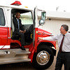 Todd Clifton, right, holds the door as Gladewater mayor Walter Derrick climbs from the cab of a fire truck Tuesday, May 15, 2012. Members of the fire department honored Derrick by chauffeuring him to his retirement reception in the truck. Clifton says Derrick was his high school football coach in the seventies.  (Les Hassell/News-Journal Photo)