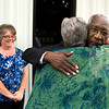 Gladewater mayor Walter Derrick gets a  hug after arriving at his retirement reception Tuesday, May 15, 2012. (Les Hassell/News-Journal Photo)