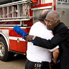 Gladewater mayor Walter Derrick, right, gets a hug from Fire Chief Wayne Smith Tuesday, May 15, 2012. Members of the fire department honored Derrick by chauffeuring him to his retirement reception in the truck. (Les Hassell/News-Journal Photo)