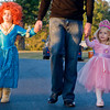 Heath Hamberlin holds hands with Princess Merida and the Pink Princess, Kate, 4, and Ava, 3,  while celebrating Halloween by attending Festival 31, on Wednesday October 31, 2012, at Mobberly Baptist Church. (Michael Cavazos/News-Journal Photo)