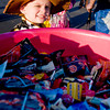 Collin Brown, 3, eyeballs a bucket of candy while celebrating Halloween by attending Festival 31, on Wednesday October 31, 2012, at Mobberly Baptist Church. (Michael Cavazos/News-Journal Photo)