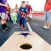 Captain America, Gregory Stevenson, 5, attempts to toss a bean bag into a hole for a chance at winning some candy while celebrating Halloween by attending Festival 31, on Wednesday October 31, 2012, at Mobberly Baptist Church. (Michael Cavazos/News-Journal Photo)