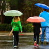 Shoppers make their way to the entrance of Longview Mall in the rain Saturday, September 29, 2012. (Les Hassell/News-Journal Photo)