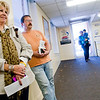 Barbara Mangrum, left, and Mark Auran, right, wait in line to pay their property taxes Thursday, Jan. 31, 2013, at the Greggton tax office building in Longview.   (Kevin Green/News-Journal Photo)