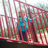 Abigail French, 18 months watching other children play as she plays at the park with her mom Anna French of Longview Monday, March 31, 2014, at Lois Jackson Park in Longview.  (Kevin Green/News-Journal Photo)