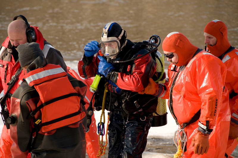 Elgin firefighter/Diver William Nangle comes out of the water disappointed in what what turned out to be a large boulder under the ice and not the body of the missing snowmobiler.