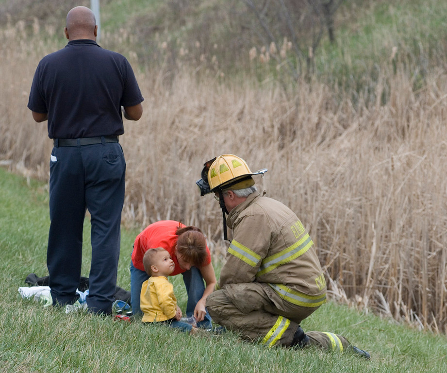 Elgin Fire Department Capt. Daryl Chapman checking on mom and child from accident.