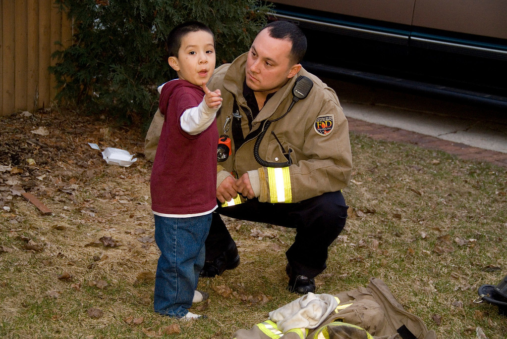 Elgin Firefighter Jarett Pump getting an intense blow by blow from a 4 yr. old who was describing the fire. ;-)