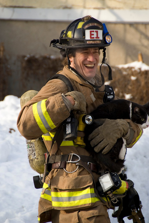 EFD Lt. Ken Nelson saving the family's cat this morning.