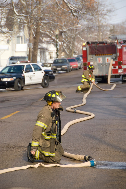"Elgin Fire Department Firefighter Lt. Stephen Frazier breaking down a line, and appearing to be reflecting on his 25+ years of service in Elgin.  This could be his last ""working fire"".  He retires in 2 weeks...."