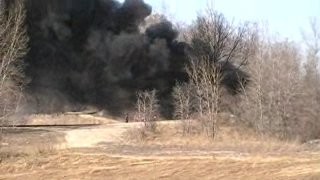 This video is firefighters scrambling from their truck when the wind shifted and totally engulfed their truck in thick smoke.