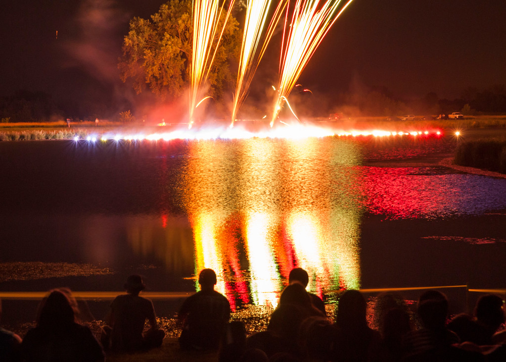 This was one of the coolest things I'd ever seen in a fireworks display.  Tubes fired with a bang, sending red, white and blue colored fireballs landing on the lake in a semi-circle.  TOO COOL!