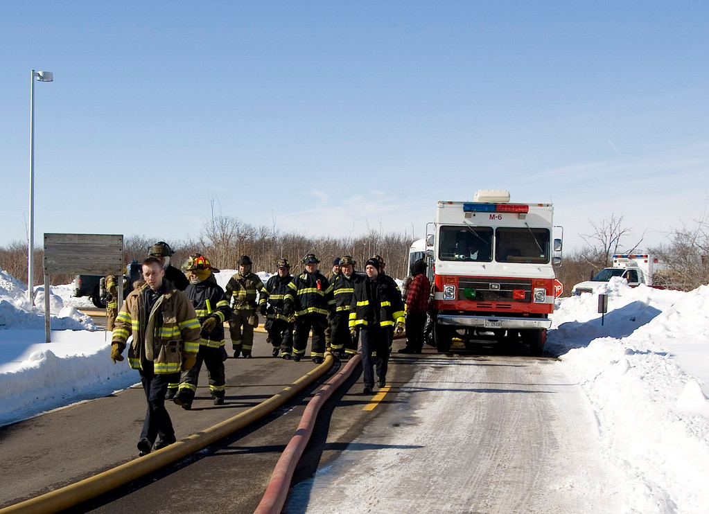 """Time to move some lines.  As this fire progressed, keeping the equipment running turned out to be a problem.  They had to move the 6"""" lines to make way for fuel trucks as everyone was starting to get low on fuel after 4 hours..."""