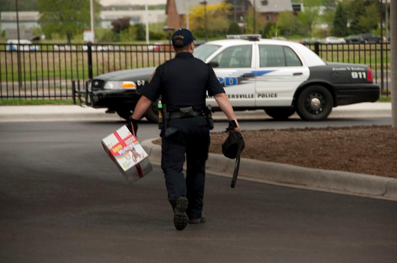 Carpentersville Police officer Joe Pilarski taking the baby's box back to the station.