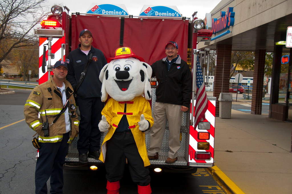 "(L to R) Lt. Brian Berry,  Firefighter Tony Ferreiro, <br /> Sparky the Fire Dog (Firefighter Scott Kapocius)<br /> Local Domino's Franchise Owner Mauricio ""Reece"" Arroyave"
