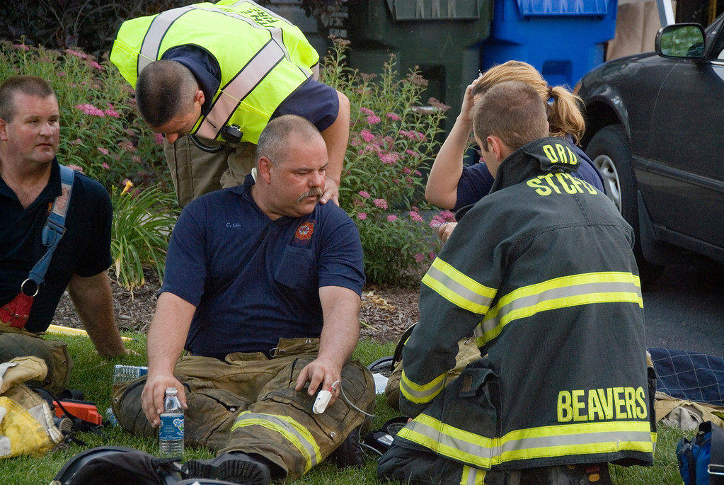 South Elgin Firefighter Lee being checked out by St. Charles paramedics.