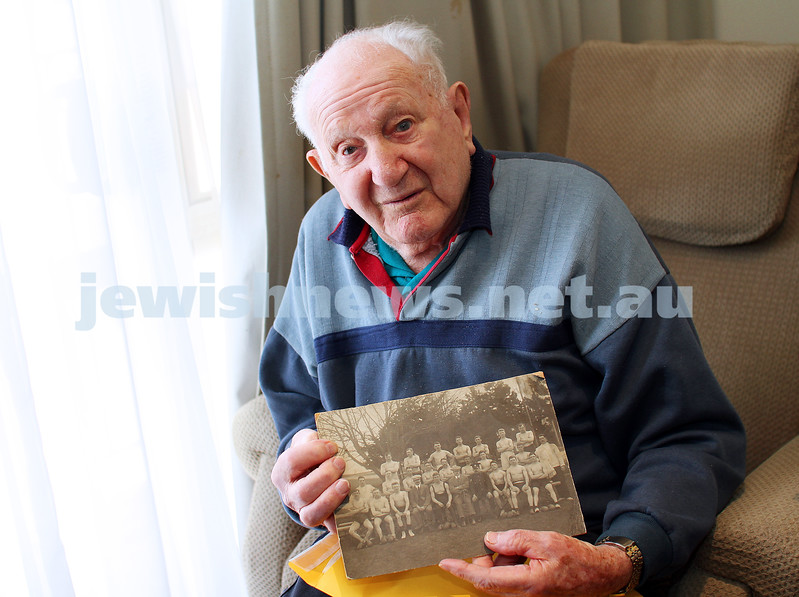 20-4-15. Sid Krasey holds up a photo showing his father Charlie Krasey (back row, fourth from the left)  who fought for England during World War I. Photo: Peter Haskin