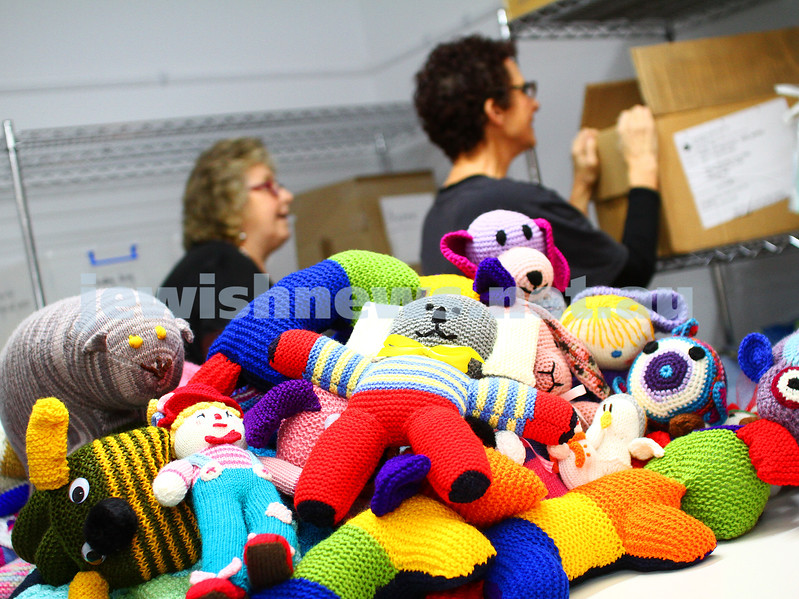 2-6-15. The ladies from KOGO sorting through hand knitted donations that they send out to womens' refuges, families in need, the homeless, indigenous communities and refugees. Photo: Peter Haskin