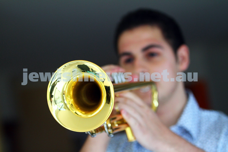 20-4-15. ANZAC Day 2015. Jarred Steinberg practising the Last Post on his trumpet which he will be playing at the ANZAC service at the Williamstow Barracks in Melbourne. Photo: Peter haskin