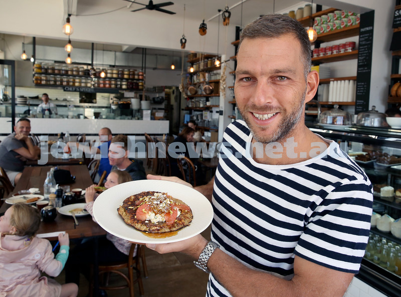 owner of Shuk Cafe in Bondi ,Yoni Kalfus with a Matzah Pancake for Pesach.