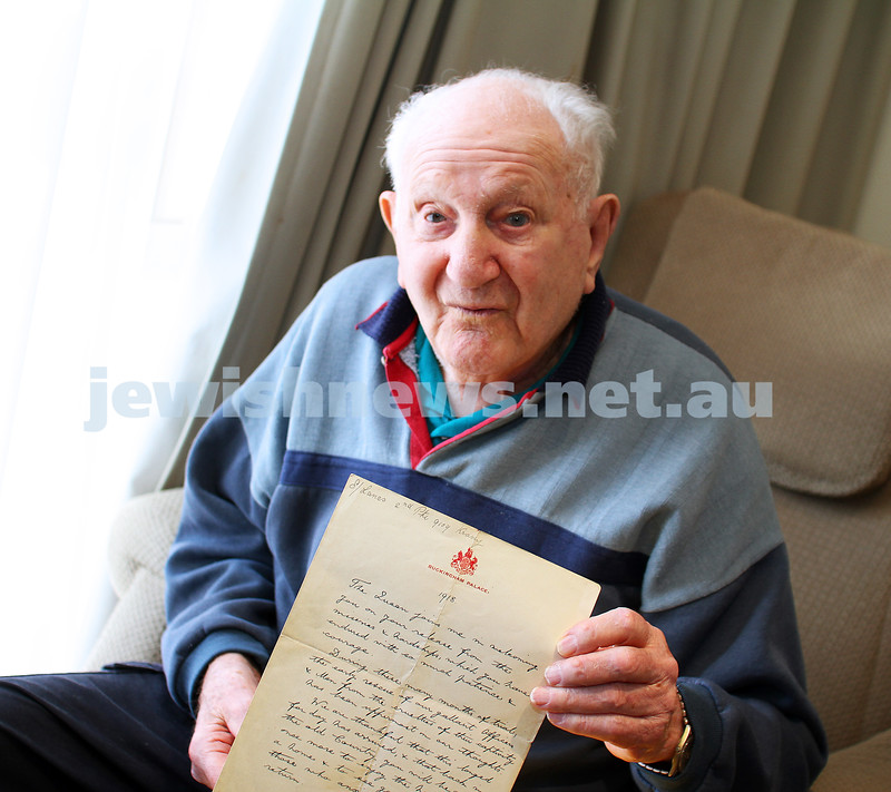 20-4-15. Sid Krasey holds up a hand written letter from King George to his father Charlie Krasey, who fought for England during World War I. Photo: Peter Haskin