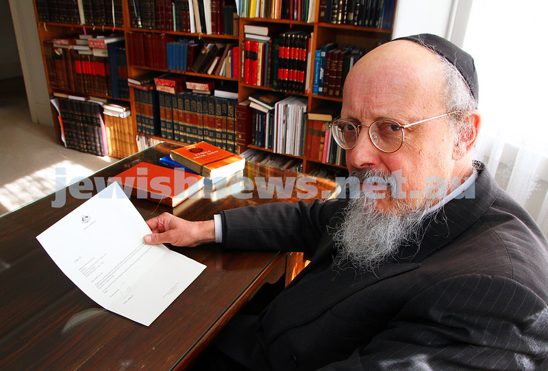 29-7-15. Rabbi Shimon Cowen holding the letter received from Prime Minister Tony Abbott in 2014 in relation to the Jonathan Pollard case. Photo: Peter Haskin