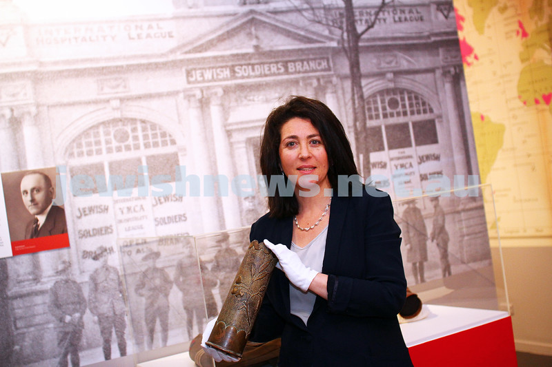 18-6-15. Jewish Museum of Australia. Curator of the upcoming World War I exhibition Deborah Rechter holding a shell casing that was tranformed into trench art. Photo: Peter Haskin