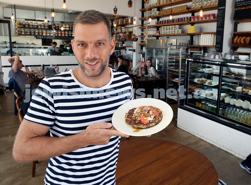 owner of Shuk Cafe in Bondi ,Yoni Kalfus with a Matzah Pancake for Pesach.
