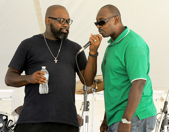 From the left: Bowtie Jones, of The Spiritual Keys and Fred Winchester, of Mind Body and Soul, share a microphone as they warm up for their performances on Friday at the annual Emancipation Park Days at Ewert Park.<br /> Globe | Laurie Sisk