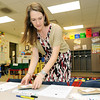 Kindergarten teacher Annette Taylor readies her classroom with supplies and treats for Open House on Sunday at St. Mary's Elementary.<br /> Globe | Laurie Sisk
