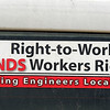A sticker graces the back window of a workers truck at the Windsor Foods construction site on Tuesday.<br /> Globe | LAurie Sisk