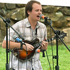 Samuel Cobb entertains with his band Spillwater Drive during the 6th Annual Big Spring Bluegrass & BBQ on Saturday at Neosho's Big Spring Park. The event featured seven bands and a bounty of food vendors to enjoy.<br /> Globe | Laurie SIsk