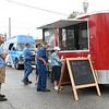 Guests wait in line to sample barbecue at one of several vendors during the 6th Annual Big Spring Bluegrass & BBQ on Saturday at Neosho's Big Spring Park. The event featured seven bands and a bounty of food vendors to enjoy.<br /> Globe | Laurie SIsk